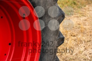 Wheels of tractor plowing field - franky242 photography