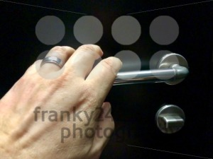 hand approaching door knob - franky242 photography