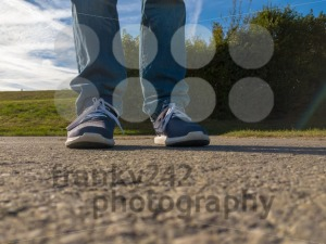 man feet on cobbled road - franky242 photography