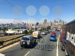 Johannesburg Central Business District buildings and roads as seen from out of a driving car. - franky242 photography