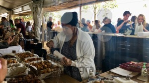 People are enjoying delicious food at a Neighbourgoods Market at the waterfront of Cape Town, South Africa. - franky242 photography