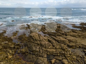 Aerial view of ocean waves and rocky coast - franky242 photography