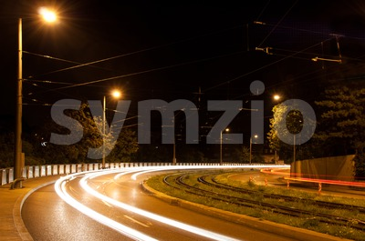 Speeding cars at night Stock Photo