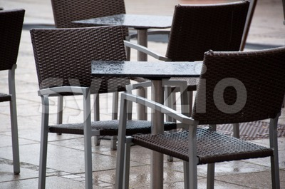 Wet Chairs And Tables Outside Cafe Stock Photo
