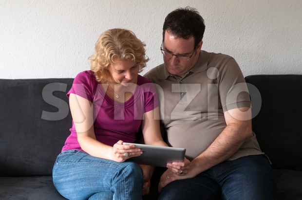 Middle-aged couple with digital tablet pc Stock Photo