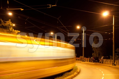 Tram at night Stock Photo