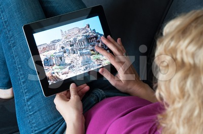 Middle-aged woman with digital tablet pc Stock Photo