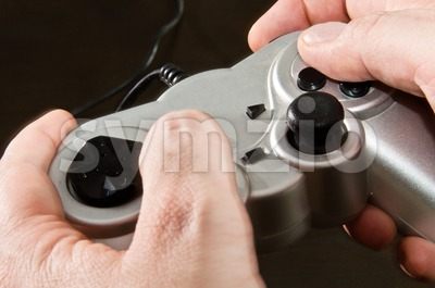 Gamepad In Hands Stock Photo
