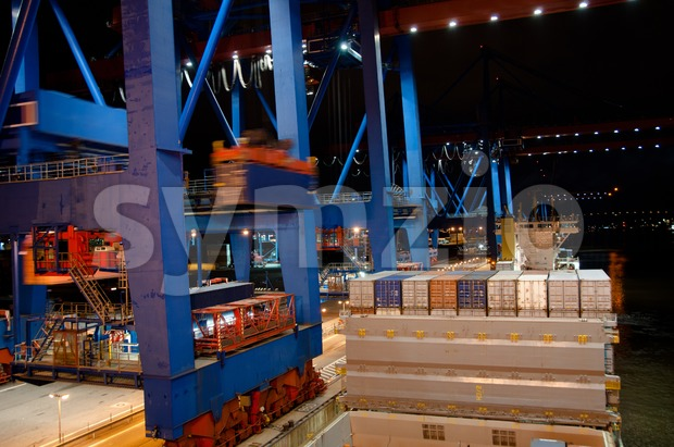 Container Ship being (un)loaded Stock Photo