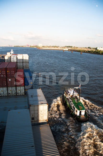 Container Ship and Pilot approaching Hamburg Stock Photo