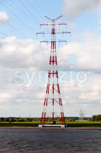 Huge Power Pole in Hamburg harbor area on blue sky background