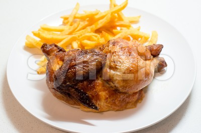 Chicken roasted with fries Stock Photo