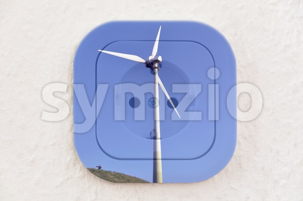 Conceptual: Wind Turbine over Power Outlet Stock Photo