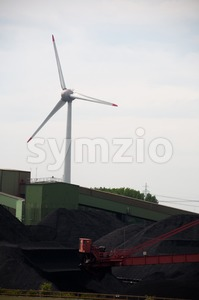 Windturbine With Coal Storage Stock Photo