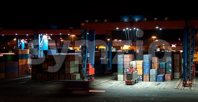 Commercial Container Port At Night Stock Photo