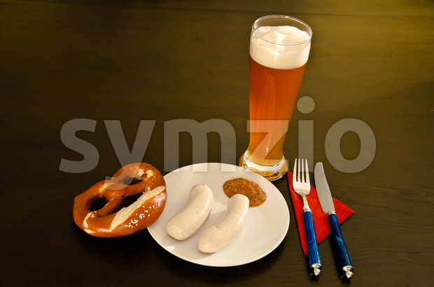 Bavarian white (veal) sausages, wheat beer and pretzel