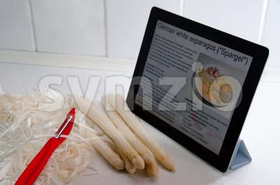 Modern Cooking with Digital Tablet PC Stock Photo