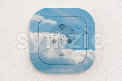 Conceptual: Birds in the Sky over Power Outlet Stock Photo