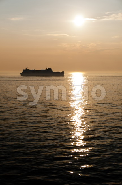 Ship At Sunset Stock Photo