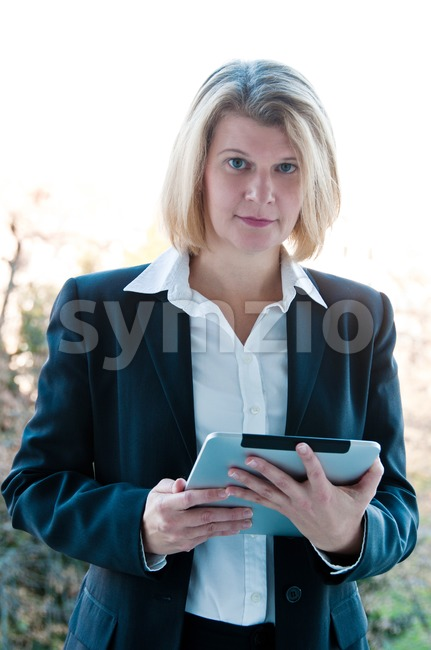 Business woman holding a touchscreen table Stock Photo