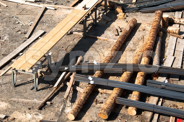 Wood and iron materials on gravel in a construction site