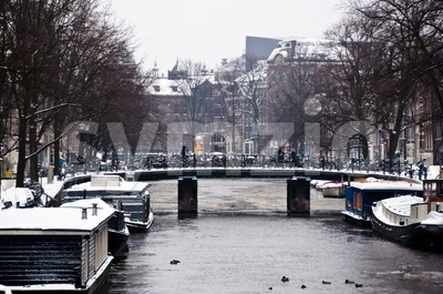 Amsterdam Canal with House Boats Stock Photo