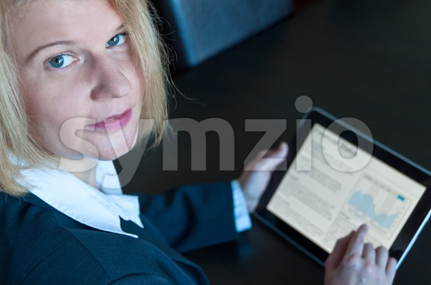 Female accountant with digital tablet Stock Photo