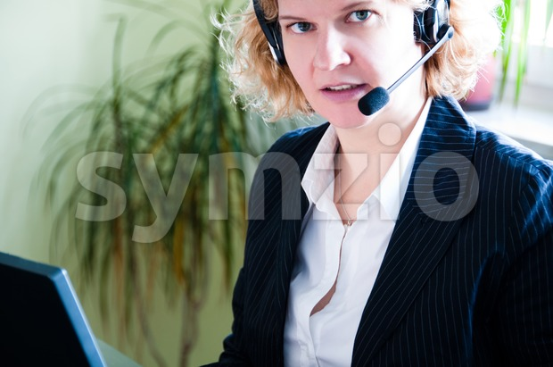 Business woman with laptop and headset Stock Photo