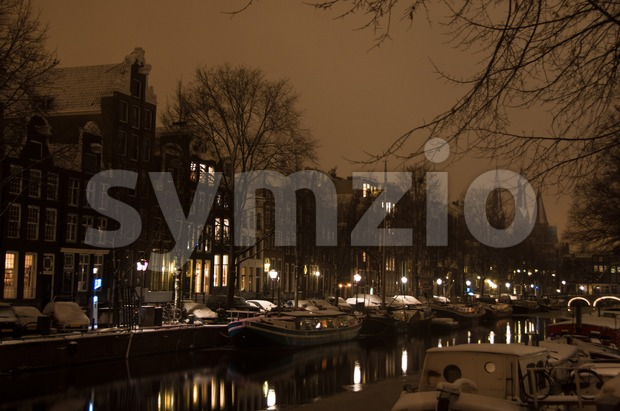 Snowy Amsterdam At Night Stock Photo