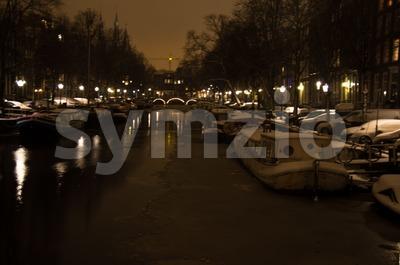 Snowy Amsterdam At Night Stock Photo