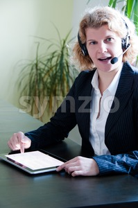 Business woman with digital tablet PC and headset Stock Photo