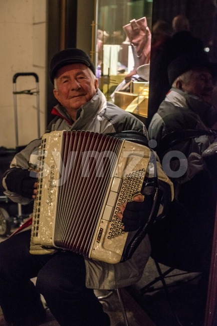 Old man playing the accordion Stock Photo