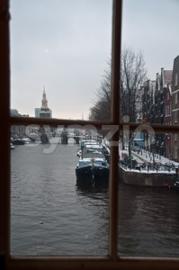 Amsterdam in snow through window Stock Photo