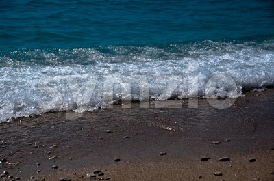 Waves hitting the beach Stock Photo
