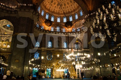 Prayer at Yeni Camii mosque, Istanbul, Turkey Stock Photo