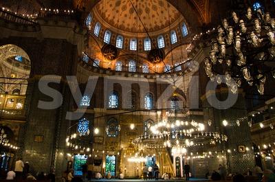 Prayer at Yeni Camii mosque, Istanbul, Turkey Stock Photo