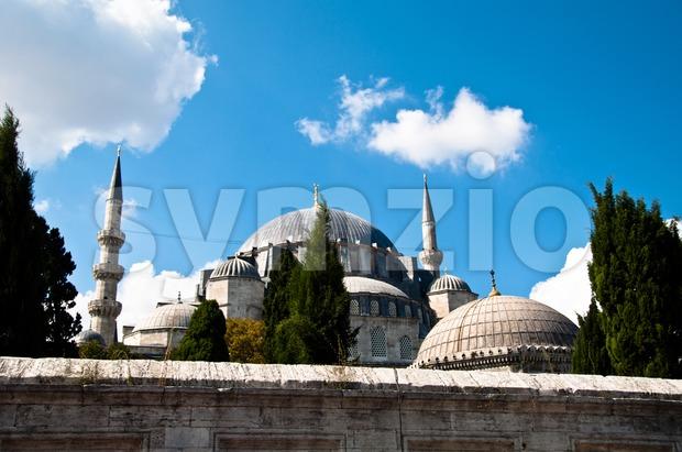 Suleymaniye Mosque in Istanbul, Turkey against great blue cloudy sky