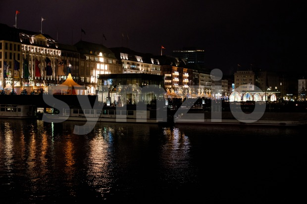 HAMBURG - DECEMBER 1, 2012: People visit traditional Christmas market around Alster river in Hamburg, Germany on December 1, 2012. ...