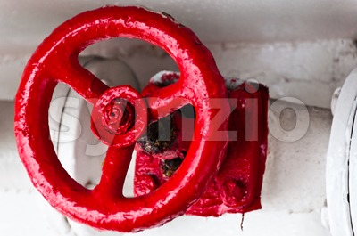 Old red plug valve Stock Photo