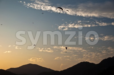 Paragliders in sunset in Turkey Stock Photo
