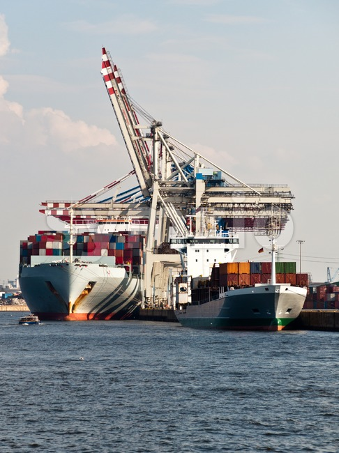 Large container ships being unloaded in Hamburg Dock, Germany. Hamburg is the second biggest container port in Europe and can ...