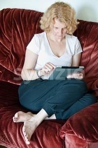 Woman browsing a touchscreen table Stock Photo