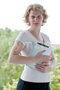 Woman holding a touchscreen table Stock Photo