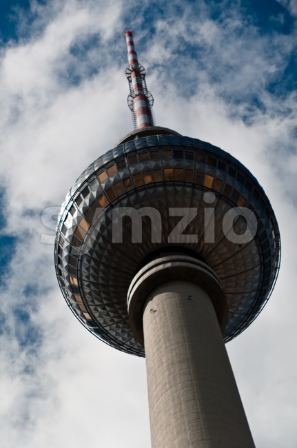 Berlin and its famous television tower at Alexanderplatz during a great cloudy summer sky