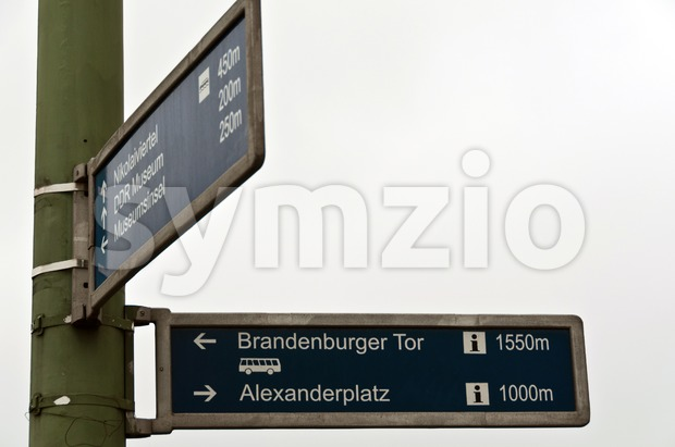 Sign post in Berlin, Germany, pointing to the city's most famous sights: Brandenburger Tor (Brandenburg Gate) and Alexanderplatz (TV tower)