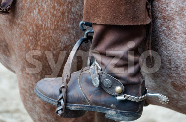 Cowboy boot with spur and horse Stock Photo
