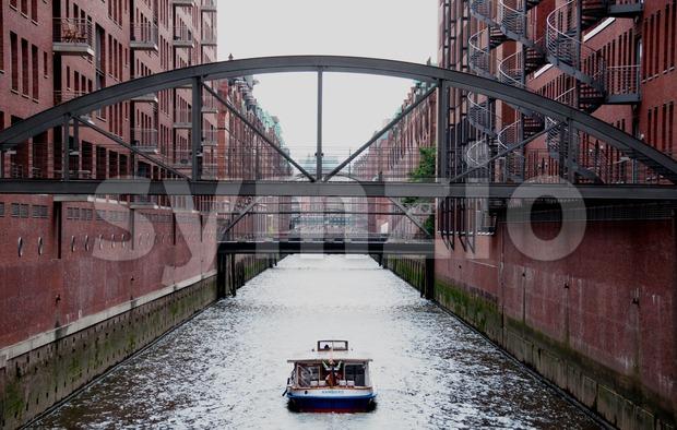 Sightseeing boat in Hamburg Speicherstadt Stock Photo