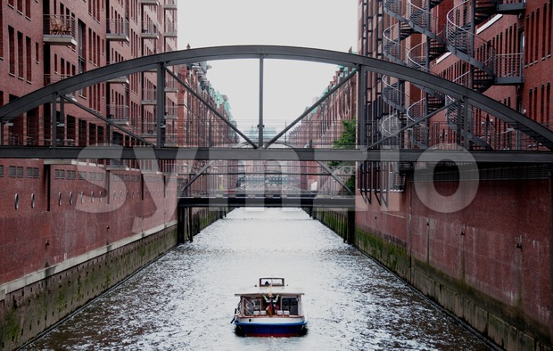 Sightseeing boat in Hamburg Speicherstadt Stock Photo