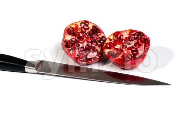 pomegranates and knife Stock Photo