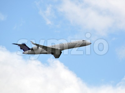 Airplane in the sky - closeup Stock Photo